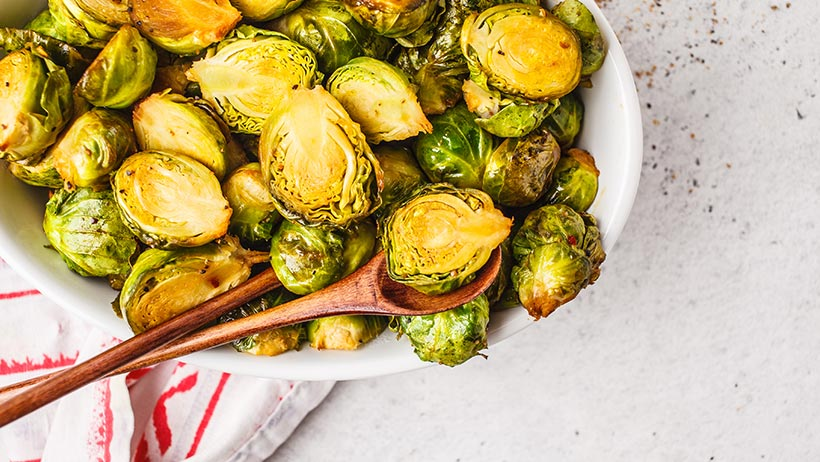 A bowl of brussel sprouts.