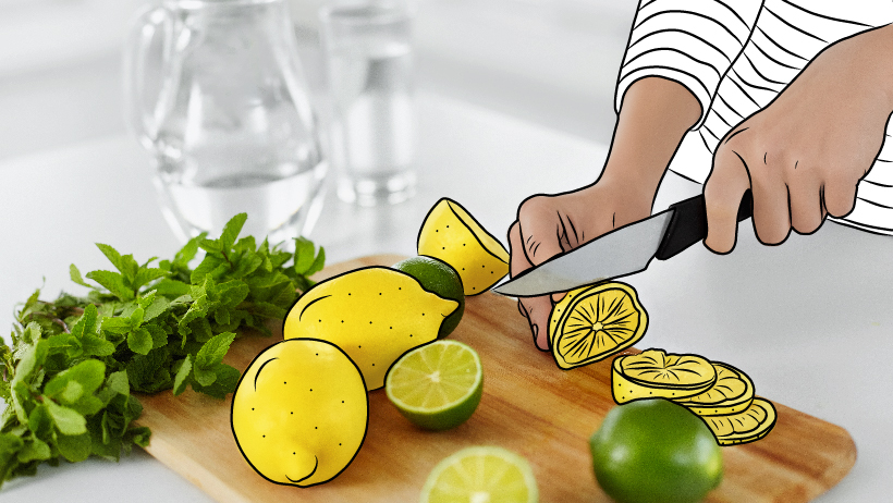 A person slicing lemons and limes