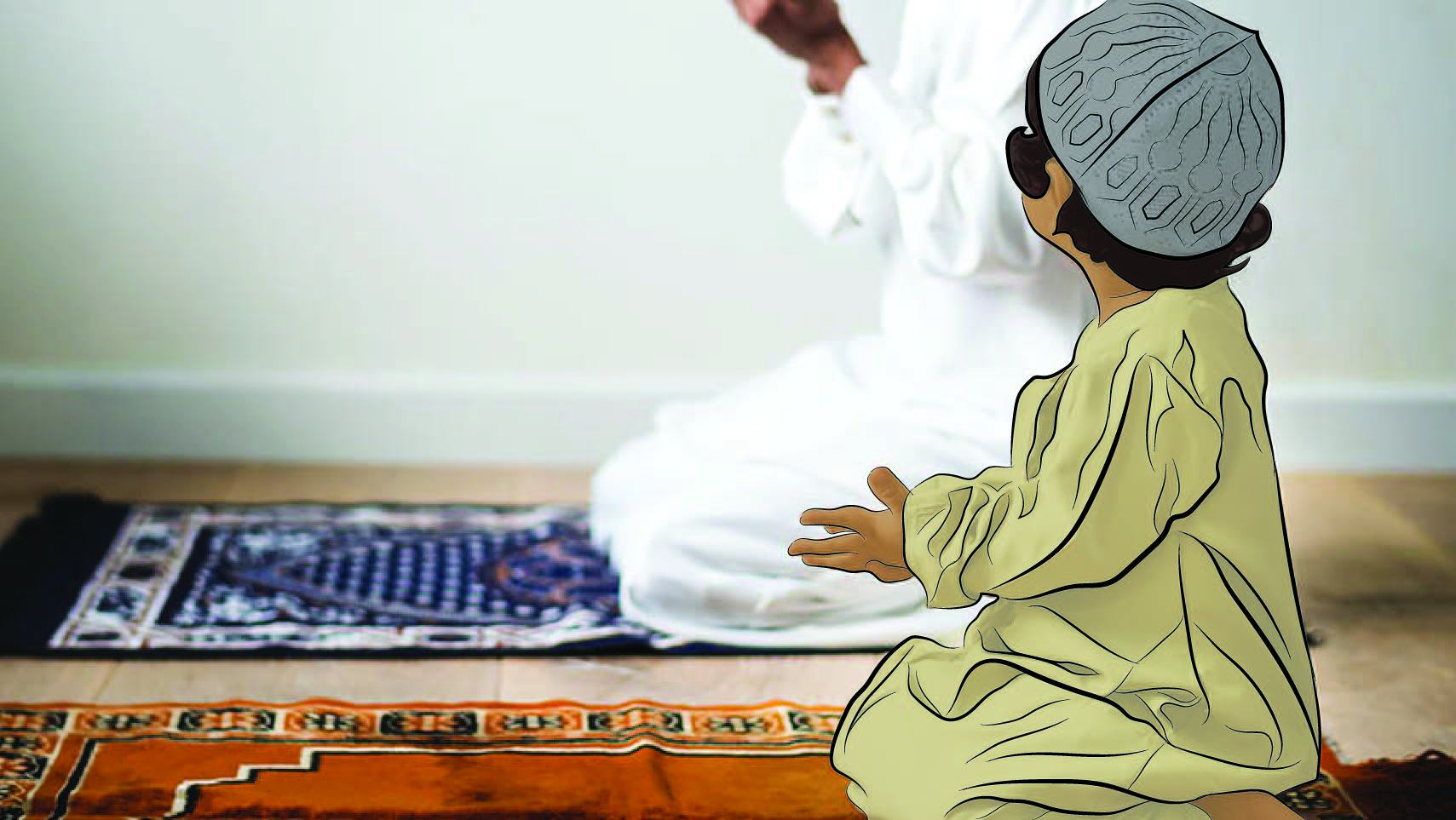 YOung boy emulating his father in prayer