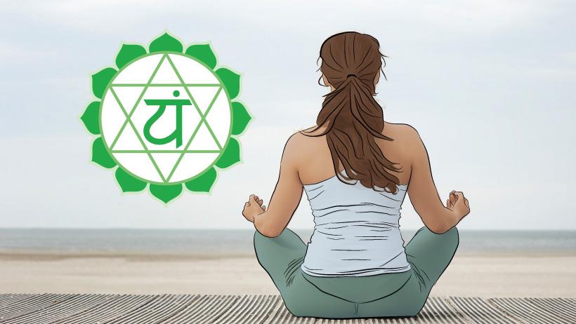A woman meditating with the heart chakra symbol.
