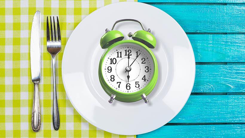 An alarm clock on a plate