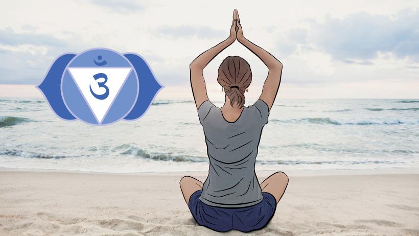 A woman meditating with the third eye chakra symbol.