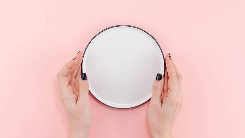 Person with an empty plate