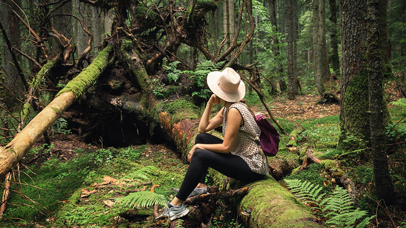 Woman pontificating in the forest