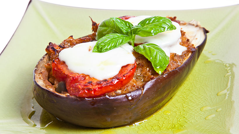 Delicious eggplant with tomato and beans.