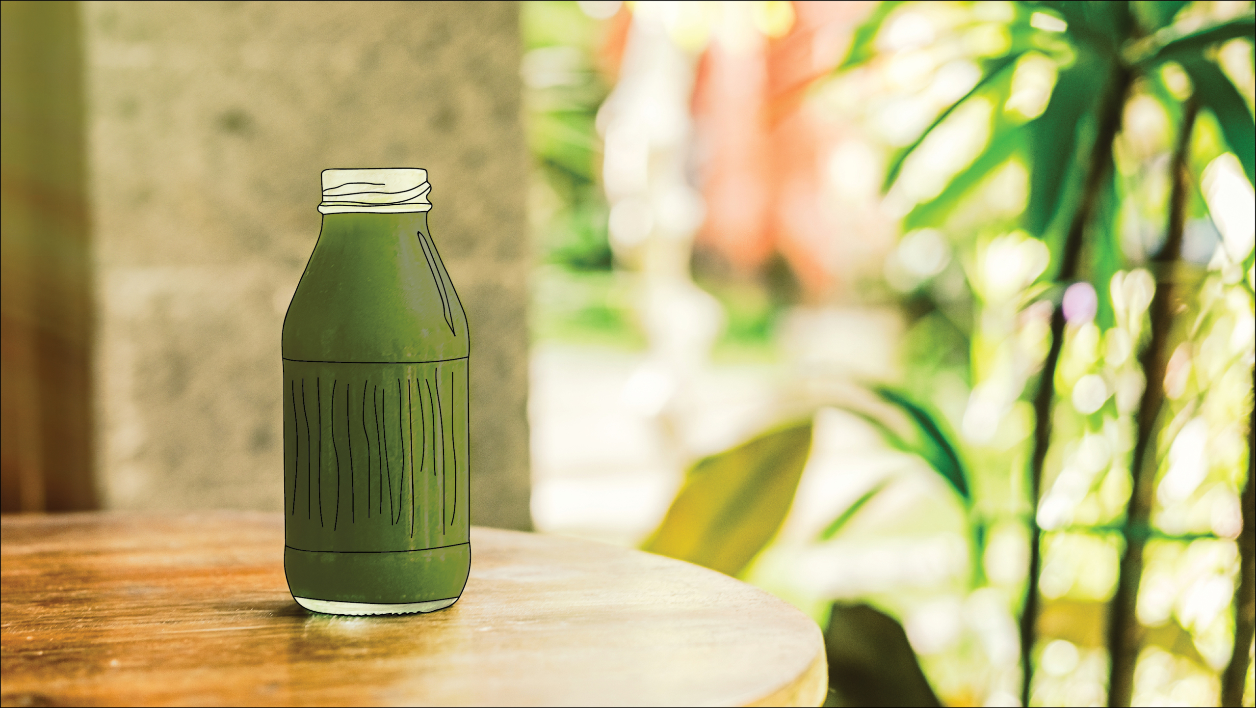 A table with one bottle of green vegetable juice