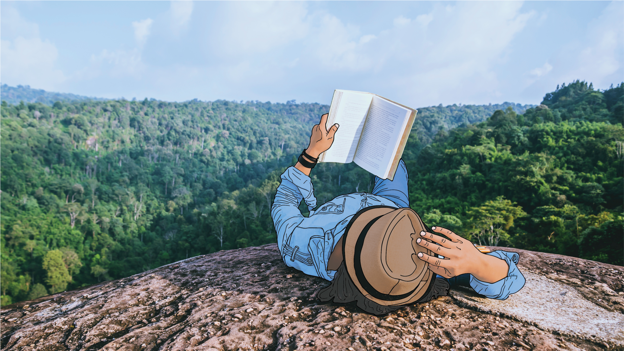 A person laying down on a mountain with a journal.